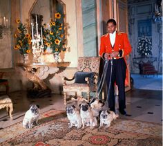 The Butler at the Duke & Duchess of Windsor's House on the Bois de Boulogne getting ready to walk the pugs