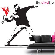 "Banksy Hooligan Wall Sticker from Red Candy. ""The flower chucker"", by Banksy. Large in red and black, on a white wall."