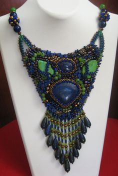 Lapis african turkuaze and with jade bead embroidery collar. $295.00, via Etsy.