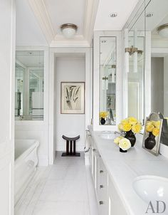 CONTEMPORARY BATHROOM BY APARICIO + ASSOCIATES  In Nina Garcia's Manhattan bath, the ceiling light is by Urban Archaeology, and the sconces and tub are by Waterworks.
