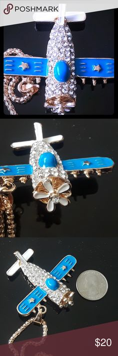 Nwot airplane blue sparkle necklace rhinestones Amazing Airplane rhinestone statement fashion bling necklace whimsical  boutique gift item so there's no tag available, new never used. No missing stones. The propeller turns...Super Cute!! Jewelry Necklaces
