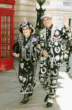 Pearly Kings and Queens, known as pearlies, are an organised charitable tradition of working class culture in London, England. A Pearly King and a Pearly Queen wear mother of pearl buttons on their suits and dresses (many are handed down from generation to generation) and today raise money for many charities and helping others.