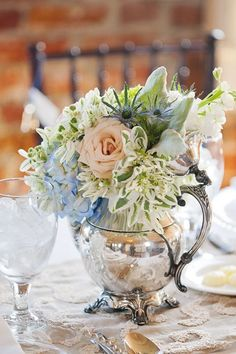 Floral Arrangement ~ vintage silver teapot filled with flowers, great idea for a centerpiece at a tea party Wedding Table Centerpieces, Flower Centerpieces, Wedding Decorations, Centerpiece Ideas, Beautiful Flower Arrangements, Floral Arrangements, Table Arrangements, Beautiful Flowers, Vintage Tee