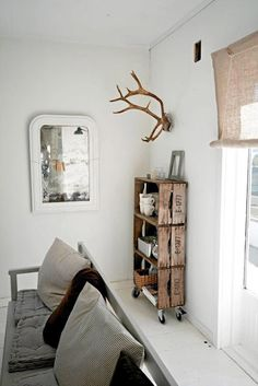 what if have crystals hanging from antlers - totally weird, I know, but I kind of like it - maybe for a guest bedroom...