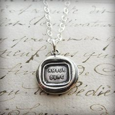 "What a beautiful statement this French Wax Seal pendant makes ~ English translation is ""Love Lasts"". (Our) Love lasts forever."