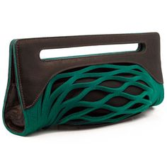 """LOVE!! Penelope clutch - A simple yet extraordinary piece! Made with designer felt (100% wool) and leather accents. Lined interior with magnetic closure and adjustable leather strap. 14"""" x 6"""" (355.6mm x 152.4mm) and 3"""" (76.2mm) deep."""