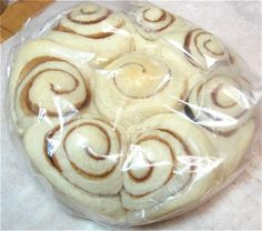 How to par-bake and freeze cinnamon rolls. I make the dough in the bread machine for the Cinnabon clone cinnamon rolls, then par-bake for 15 minutes. Let buns cool in pan then flash freeze. When frozen, remove from pan and store in plastic bag until needed. Thaw overnight in the fridge and then bake at 350 deg. for ~ 15 mins til lightly browned. Spread icing on buns while warm.