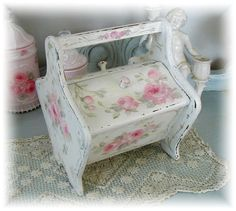 Buy and old Sewing Box Tote -- paint it white and clip out magazine pictures of flowers and decoupage them on.