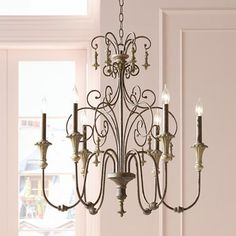 "Scrolled Tiers 28"" Wide Beige Accents Bronze Chandelier $249,95 Bronze finish. Beige accents. Takes six 60 watt candelabra bulbs (not included). Inspired by French country style. 28"" wide. 30"" high. Includes 6' of chain and 12' of wire. Canopy is 6"" wide. Hang weight is 16 lbs."