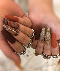 "If you're unfamiliar with nail trends and you hear the words ""coffin nails,"" what comes to mind? It's not nails with coffins drawn on them. Although, that would be a cute look for Halloween. It's long nails with a square tip, and the look has. Round Nails, Oval Nails, Perfect Nails, Gorgeous Nails, Trendy Nails, Cute Nails, Cute Fall Nails, Simple Fall Nails, Pointed Nails"