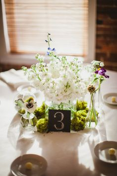 Love the pretty simplicity of these wedding centerpieces - Blue and yellow organic floral centerpieces by The Conservatorie