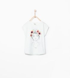 Printed T-shirt with appliqués