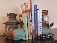 Made of heavy polyresin, painted in dark turquoise with a lightly distressed finish, this set of 2 Whale Bookends with their flipping tails will be a great gift for your favorite book lover.A beach b