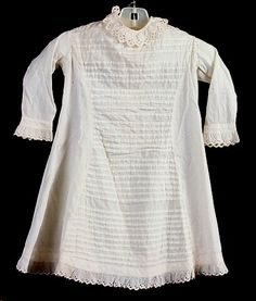 Dress, child's, off-white cotton, princess line with pin-tucked panel, 1870-1879