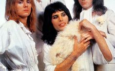 Queen photo shoot. Freddie, you were supposed to leave the cat at home.