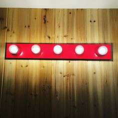 Fire engine red light fixture with LED bulbs on knotty cedar tongue and groove…