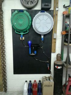 Drain pan and funnel storage..... Pex fittings and vinyl tubing for mess free storage.