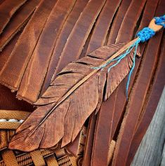 Tooled leather feather for the grips Leather Stamps, Leather Art, Custom Leather, Leather Cuffs, Leather Design, Leather Jewelry, Leather And Lace, Tooled Leather, Handmade Leather