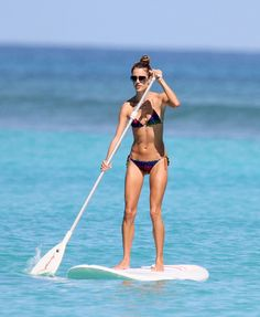 Stand Up Paddle Board... So. Much Fun! Would love to do it on the blue water in Hawaii