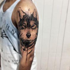 Watercolor wolf tattoo by Felipe Mello