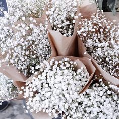 Keeping beauty to a minimal. White wild flowers wrapped in brown paper.