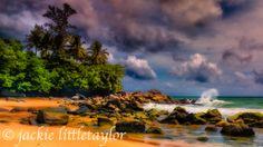 waves crashing along coast dark clouds Laem Singh 16x9 Phuket Thailand