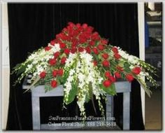 Casket Spray with South American Roses and White Dendroniums, Funeral Flowers, Sympathy Flowers, Funeral Flower Arrangements from San Francisco Funeral Flowers.com Search for chinese funeral, sympathy funeral flower arrangements from our SanFranciscoFuneralFlowers.com website. Our funeral and sympathy arrangements include crosses, casket covers, hearts, wreaths on wood easels, coronas fúnebres, arreglos fúnebres, cruces para velorio, coronas para difunto, arreglos fúnebres, Florerias…