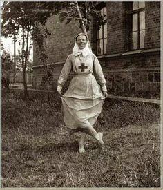 Grand Duchess Olga Alexandrovna Romanova of Russia in her nursing uniform goofing around.A♥W