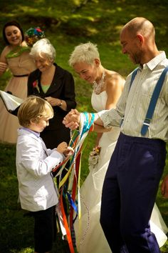 Instead of the customary handfasting cords I'd like to have each guest come tie a ribbon around my partners and I hands so I could later display all of the well wishes