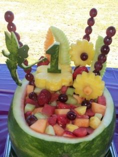 A beautiful watermelon carving true to the 1st birthday theme and Tinkerbell.  See more first girl birthday party ideas at http://www.one-stop-party-ideas.com