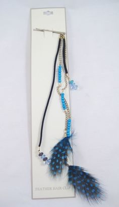 "This is a very fashionable 9""-10"" long feather hair clip featuring blue and black feathers and assorted beading as pictured. This is part of a large overstock purchase we made and comes brand new with tags from Walmart Stores."