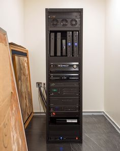 Home technology equipment rack | Two Houses, Both Alike | CEDIA Integrated Home Design Ideas