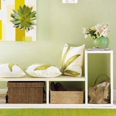 entryway design with bench, storage baskets and decorative pillows