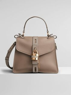 Get one of the hottest styles of the season! The Chloé Small Convertible Motty Grey Leather Shoulder Bag is a top 10 member favorite on Tradesy. Grey Leather, Calf Leather, Leather Shoulder Bag, Shoulder Bags, Shoulder Strap, Leather Satchel, Leather Handbags, Chloe Handbags, Day Bag