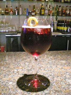Red Wine Spritzer: (LowCal)  3 oz. red wine  6 oz. club soda  Garnish: fruit wedge  Pour red wine and club soda into a coupe filled with ice. Garnish with a fruit wedge. CHEERS!