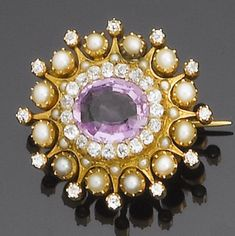 A late 19th century pink topaz, diamond and half-pearl brooch, circa 1890  The oval mixed-cut pink topaz within an old brilliant-cut diamond border, to a half-pearl and old brilliant-cut diamond starburst surround, diamonds approx. 1.30ct. total, length 3.5cm.