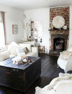 love this. dark floors. fireplace. rustic. the walls need some color though!