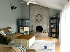 Sherwin Williams Magnetic Gray in a living or family room with vaulted brick fireplace and farmhouse decor. Kylie M INteriors e-design and online color consultant Green Family Rooms, Family Room Colors, Family Room Design, Living Room Colors, Blue Green Paints, Blue Gray Paint, Green Paint Colors, Room Paint Colors, Blue Grey