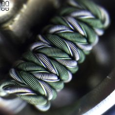 This is the first of the post dry-fire shots from this build. I have a few more and have not decided yet which ones I'm gonna post. The 40 gauge Nichrome 80 from @kidneypuncher puts out the same intense green as the 36 gauge N80 from them. It seems that swapping the alloys of the cores made no apparent impact but I AM pretty pleased with the decision to use one strand of KA1 and one strand of N80 for the helix instead of both being N80. It doesn't affect performance at all but I prefer the…