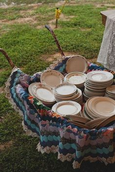wheelbarrow quilt and mixed china for a buffet / http://www.deerpearlflowers.com/wagon-wheelbarrow-country-wedding-ideas/