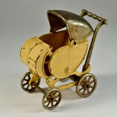 Vintage cast iron metal toy baby carriage attributed to Hubley or Kilgore