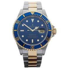 Rolex Yellow Gold Stainless Steel Submariner Sun Burst Automatic Wristwatch    From a unique collection of vintage wrist watches at https://www.1stdibs.com/jewelry/watches/wrist-watches/