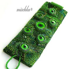 Dragon Eyes Bracelet by mischka.anna, via Flickr. Wow. This is really cool