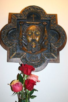 Carmel of the Holy Face of Jesus   cosmic quicunx in brass, plaque of the Holy face as imprinted on Veronica's veil, surrounded by the instruments of our Lord's Passion: scourge (L), crown of thorns (base), hammer and nails (R), cross (top)   Discalced Carmelite Nuns (OCD) Hague, North Dakota - Diocese of Bismarck