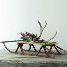 Vintage Wooden Sled  Like the antlers casually laying on top