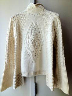Heavy Alexander McQueen cable-knit sweater.