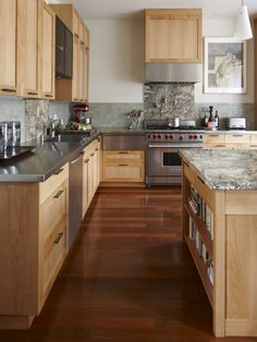 Natural Maple Kitchen with stainless steel countertops and granite island
