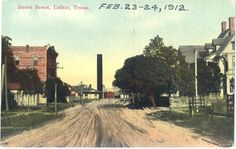 Ellis Street Lufkin 1912. Looking East from Ellis Street towards the H.E. & W.T. RR Depot & town water tower (Stand Pipe) in the center. Bonner Hotel on the left. Shearer home on the right.