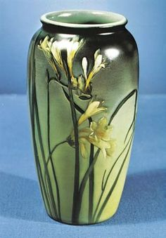 An American vase painted in colored slips under glaze came from Rookwood Pottery in Cincinnati, Ohio, about 1900