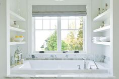 Clean and elegant bathtub design with built-in shelves. 1 of 4 projects by Susan Marinello Interiors.